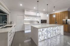 This transparent, white crystal has barely visible delicate patterns reminiscent of glinting light reflecting off Antarctic ice glaciers. White Quartz semi-precious slabs radiate a serenity that is perfectly in harmony with any luxury home design.