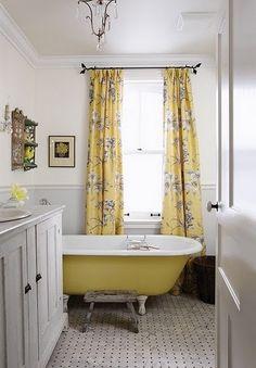Butter yellow clawfoot tub. Sarah Richardson Design