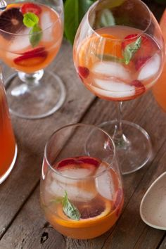 Citrus and basil sangria: fresh strawberries, tangerine juice, brandy, wine and basil syrup