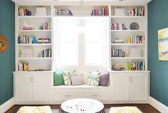 Traditional Guest Bedroom with Crown molding, Chandelier, Window seat, Built-in bookshelf, Target Frontier Pouf, Bay window