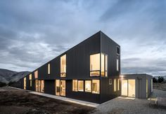 Wanaka Wedge House | Actual Architecture Co. | Archinect Architecture Company, Architecture Photo, Grand Designs New Zealand, Whole House Fan, Wedge, Curved Wood, Narrow House, Wood Ceilings, Global Design