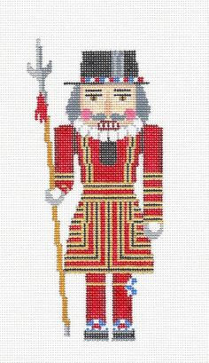 Susan Roberts ~ A beautiful, very detailedNutcracker British Beefeater with Lance hand painted mesh canvas. Needlepoint By Wildflowers. Xmas Cross Stitch, Cross Stitch Needles, Cross Stitching, Cross Stitch Embroidery, Cross Stitch Patterns, Needlepoint Designs, Needlepoint Kits, Needlepoint Canvases, Needlepoint Stockings