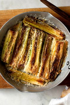 NYT Cooking: My friend Elizabeth tells me that even people who think they don't like leeks like this dish. The leeks are braised in wine and water or stock until soft and golden, then topped with Parmesan and run under a broiler, so you get a crunchy layer on top of soft cooked leeks. One of the tricks here is to discard the outer layers that become papery when you cook them, so that the whole leek will be ...