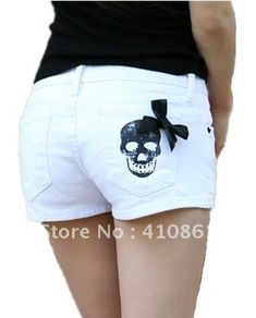 these are cute <3 white with black skull shorts and bow