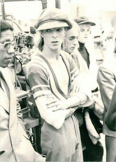 DAVID BOWIE & MICK RONSON, and Woody Woodmansey, the Spider's drummer and next to David is his bodyguard Stu George I believe