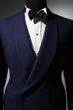 amator-blogosphere:  Double breasted smoking jacket in midnight blue wool herringbone twill, with shawl collar, self-covered buttons and besom pockets