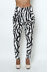 High waist zebra print loose skinny pantsThese stretchy animal print pants feature a high waist band, two side pockets, and loose crotch withfitted skinny ankles. Be fierce and fun with these hot pants! 90% POLYESTER 10% SPANDEXHAND WASH COLDDO NOT BLEACHHANG DRY