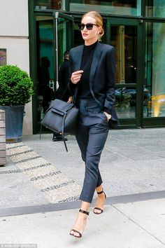 Made for her: The longline tailored blazer perfectly hung off her model frame and as the lingerie-model strutted her stuff she treated the pavement like a catwalk