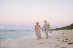 The happy couple takes a stroll on the beach after the ceremony on Paradise Island, Bahamas Photo by Katie Kaizer Photography #beach #bahamas #wedding #destination #travel #tropical