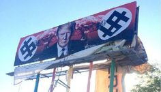 The billboard that went up Friday and features a photo of Trump's face flanked by what appear to be nuclear mushroom clouds and dollar signs that resemble swastikas. (Photo courtesy of Karen Fiorito, via Twitter)