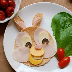 fun! Thumper's wrap sandwich    1 whole wheat tortilla  1 slice turkey  1 slice ham  1 slice low fat yellow cheese (such as American)  1 slice low fat white cheese (such as provolone)  2 olive slices  Lettuce and tomatoes for garnish
