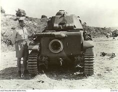 DURING THE SYRIAN CAMPAIGN AN AMERICAN ARMY SPECIALIST IS SHOWN EXAMINING VICHY FRENCH TANKS WHICH WERE CAPTURED BY THE BRITISH.