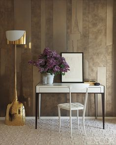 Desk by Nicolas Aubagnac holds a Tamara de Lempicka drawing, chair is by Archirivolto, and the floor lamp is by Philippe Hiquily