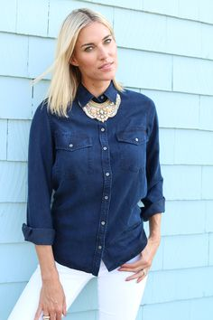 Style a chambray shirt with a bold statement necklace for a simple outfit that works for any season