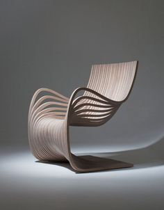 This gracefully curving wooden chair is one of the latest pieces exquisitely crafted by designer Alejandro Estrada. The Pipo Chair, produced for sale by Gu design, Chair with Sexy Curves Constructed Entirely from Two Pieces of Plywood Unique Furniture, Contemporary Furniture, Furniture Stores, Funky Furniture, Cheap Furniture, Modern Furniture Design, Office Furniture, Bedroom Furniture, Latest Furniture Designs