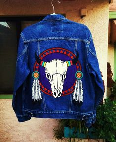 Cow skull on sheild with feathers hand painted on a Levi's denim jacket by @bleudoor on Instagram