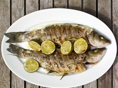 When buying whole fish to prepare for the grill with this Grilled Branzino with Basil, Lime and Ginger, don't hesitate to ask the fishmonger to gut and scale your selection.