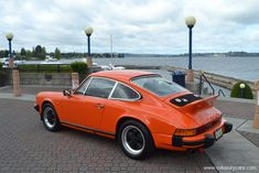 Stunning and rare Continental Orange1976 ROW Porsche 911 coupe. Gorgeous body, paint and interior. Lightweight non sunroof spec and simply stops traffic!