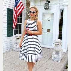 """Eliza J fit and flare dress!!! A wide red belt adds a fun pop of color to this beachy striped day dress styled with fun inverted pleats and a cutout upper back.  Super cute for a day at a 4th of July soirée or maybe even the horse races!!  35001115                  Measurements:  22"""" pit to pit laid flat, 20"""" waist laid flat and length is 40"""" neck to hem. Eliza J Dresses"""