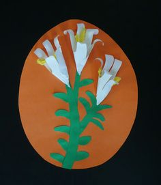 How to Make Paper Easter Lilies - Trace hand 3 times on white paper. roll together and glue. twist a bit of yellow tissue paper for the center of the lily.