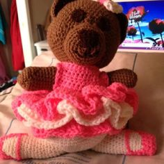 Dance recital bear. Made this from a simple bear pattern. I made the legs in white and made the slippers separate then sewed them to the feet. The tutu is made of three ruffled pieces off the top of my head. I'm sure there are pattern available on the Internet.
