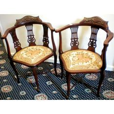 A Pair Of Walnut Edwardian Corner Chairs, With Upholstered Seats