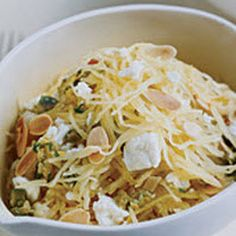 Spaghetti-Squash with toasted almonds, scallions, and feta