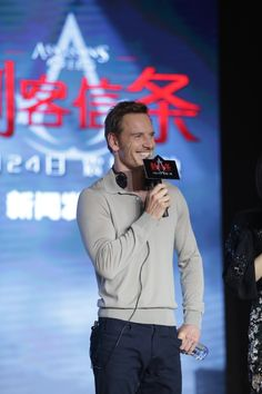 Beijing China Assassin's Creed promo / smile / mic
