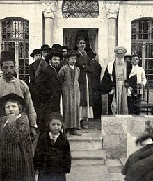A Baghdadi rabbi with Hasidic students and Syrian Jews at a wedding celebration in Jerusalem, 1904.