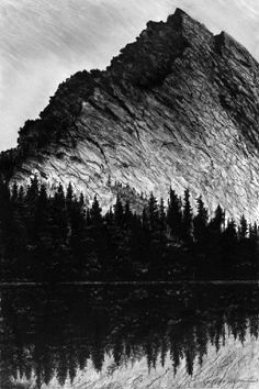 The exuberant crags of Idaho's Harrison Peak tower over the placid waters of Harrison Lake, in an august summer spectacle of dignified, unassailable power. This original is available. Contact me for more information.