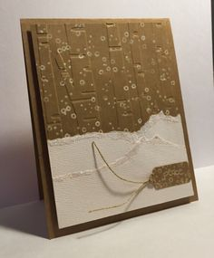 """""""Peace"""" sled on glitter-topped """"snow"""" on snow-stamped, birch tree-embossed kraft handmade Christmas card."""