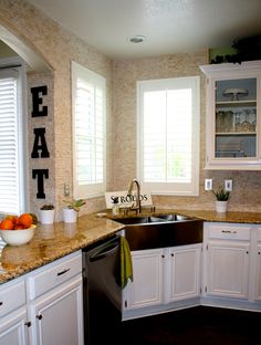 Things to be Stroud Of: Kitchen | This kitchen makeover features a tile backsplash that extends all the way up the walls, around the corner and across an archway into the next room. Awesome.