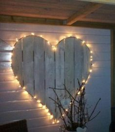 Pallet heart with twinkle lights...cut from single pallet or assemble a 'fence' section and cut. White wash or use color. Wedding decor, patio or indoors also.