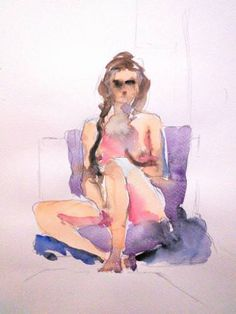 Woman sitting on a purple towel