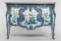 Commode, Matthieu Criaerd, working under Thomas-Joachin Hébert, 1742. Collection of Louvre Museum. A more colorful, feminine commode stood in the Château de Choisy bedroom of Madame de Mailly, Louis XV's mistress.