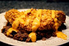 Tortilla Crusted Chicken with Black Bean and Rice Medley - Amazing recipe that our family has been cooking up for years! Served on top of a bed of delicious black bean and rice medley. Add chicken, 2 eggs, milk, and butter. Top off with your favorite queso for an extra treat!