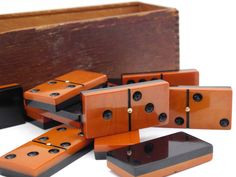 Extremely rare two tone Bakelite / Catalin domino set. A beautiful slightly marbled brown with a black back completed with brass pins / spinners / Orange Is The New Black, Back To Black, Black And Brown, Dinner Party Games, Orange You Glad, Brass, Antiques, Beautiful, Antiquities