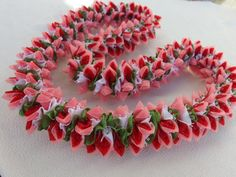 The lei is approximately 36 inches long material/satin ribbon、organza ribbon color/ red, pink, green and white