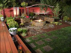Too much stuff going on in this photo- but I love the way the stepping stones go from the grass to the fire pit area.