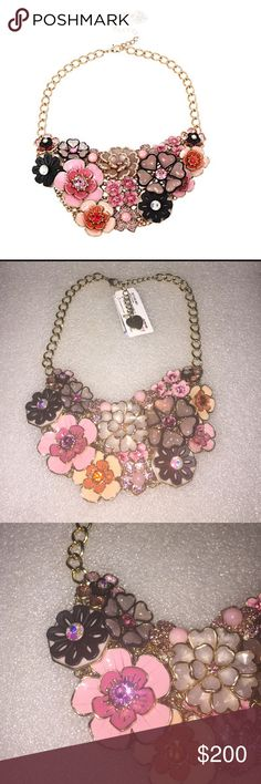 Betsey Johnson necklace Selling to buy Betsey pieces I need. This is from the memoirs of Betsey Johnson. The necklace is gold tone. The charms include lots of flowers. There are also flowers with encrusted rhinestones. NWT Betsey Johnson Jewelry Necklaces