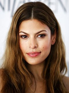 Eva Mendes hairstyle inspiration: center part, casual beauty.
