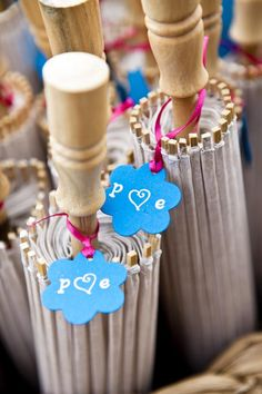 Parasols with personalized tag made out of card stock, paint pen and ribbon.
