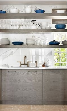 Love love love the gray stained wood cabinets, bridge faucet and marble backsplash.