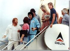 Elvis Presley departing the Lisa Marie with Linda Thompson in Shreveport on July 1, 1976 (also in the photos are Red and Sonny West, Rick Stanley, Lamar Fike and Charlie Hodge)