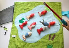 Fishing Play Mat.  Too cute and it rolls up pretty small for a shoe box