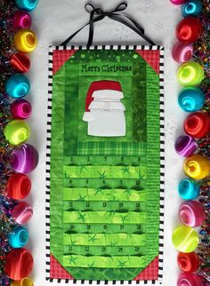 Advent Calendar - Quilted Santa Claus in Bright Green and Holiday Red - Countdown to Christmas. $75.00, via Etsy.