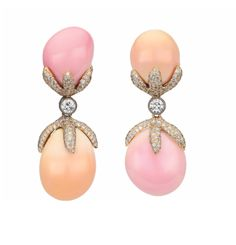 An Exceptional Pair of Conch Pearl and Diamond Ear Pendants: Each alternately suspending a pink or orange conch pearl from a foliate pavé-set diamond cap, to the circular-cut diamond spacer link and similarly designed surmount, mounted in yellow gold Coral Jewelry, Gems Jewelry, Fine Jewelry, Pink Earrings, Pearl Earrings, Diamond Earing, Modern Jewelry, Beautiful Earrings, Diamond Cuts