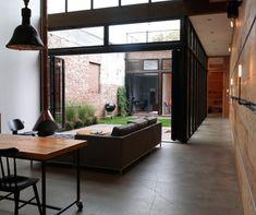 An internal courtyard adds a sense of calm to this New York city home. Image via Inhabitat.