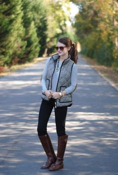 Puffer vest paired with an elbow-patched sweater (J Crew), sunglasses (Anthropologie), travel pants (Lilly Pullitzer), and English riding boots (Tory Burch)