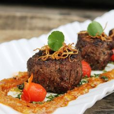 Grilled Dry Aged Beef Filet Mignon Tenderloin Steak with Roasted Garlic Sauce, Tomato Confit and Topped with Crispy Deep Fried Ginger.
